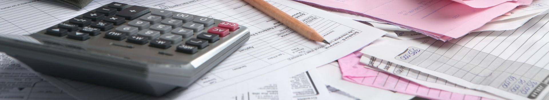 Calculator and paperwork