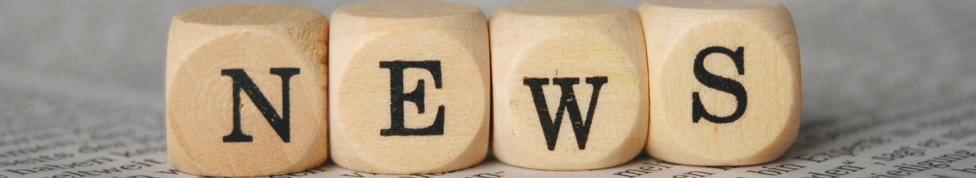 News written with lettered dice